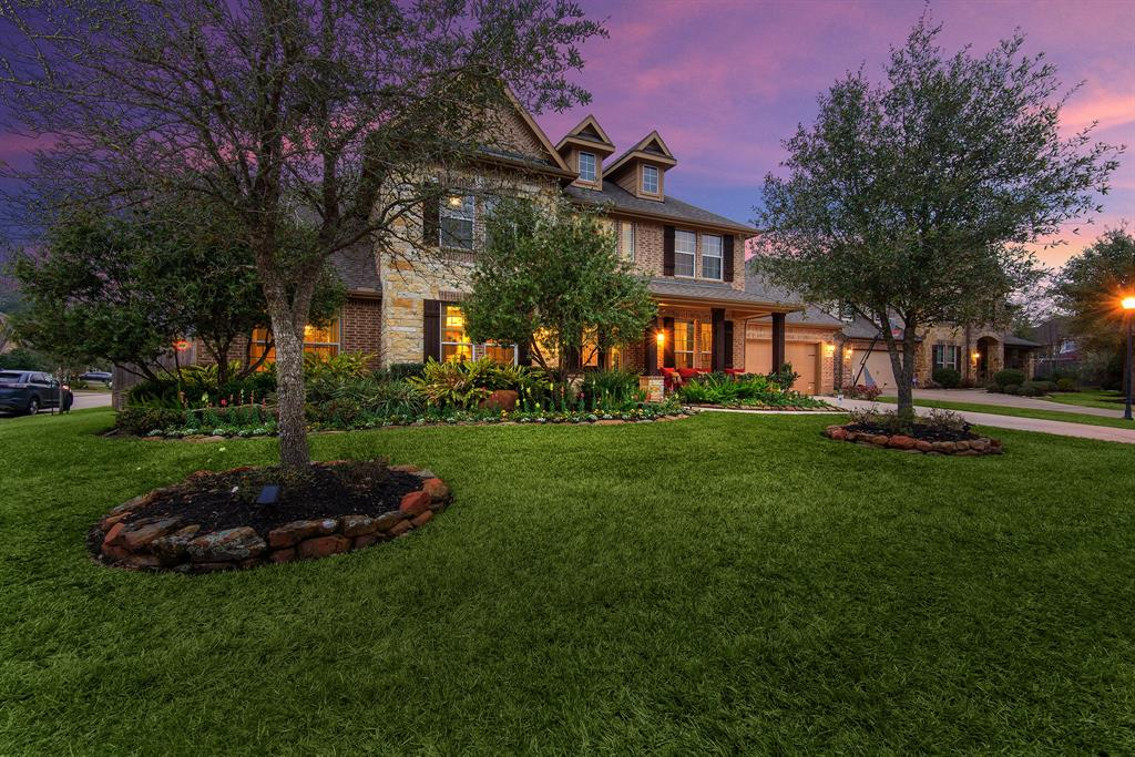 Absolutely Stunning 5-7 bedroom, 3 car garage home in the heart of KISD!  Gorgeous outdoor kitchen, living, and dining areas overlooking tropical pool/spa!  Beautiful stone and brick elevation with front  porch and stained cedar accents welcome you to this amazing property!  Entry with wood/tile flooring, soaring ceilings, custom light fixtures, and an elegant spiraling staircase featuring wrought iron spindles!  Gorgeous formals featuring crown molding, coffered ceiling, and beautiful lighting.  The XXL island kitchen is a chef's dream featuring stainless appliances, 3 ovens, gas range, butlers pantry, and breakfast bar.  Huge living room with floor to ceiling limestone fireplace and cedar mantle!  Master retreat with amazing closet; bathroom featuring dual vanities, huge corner jacuzzi tub, & separate shower! The secondary staircase from kitchen leads to a huge gameroom and home theater!  Outdoor paradise with amazing pool/spa, outdoor living and dining/kitchen, limestone fireplace!