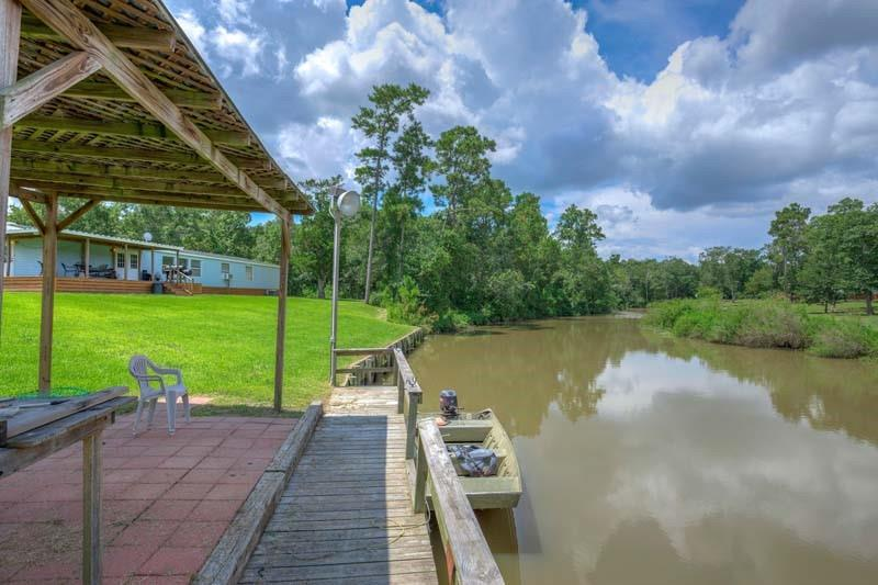 Incredible waterfront ranch less than one hour from downtown Houston. The ranch has nearly 6,000' of frontage on West Fork of Double Bayou which is a deep navigable waterfront that leads directly to Trinity Bay. Cross fenced property with three homes on well landscaped waterfront with 600' of bulkhead and three lighted fishing docks. A year-round creek runs through the middle of the property. Terrific get away from Houston in a very private setting. Excellent long term investment with so much navigable water frontage that could be further developed. This is an excellent private waterfront retreat, with great boating, fishing and hunting.