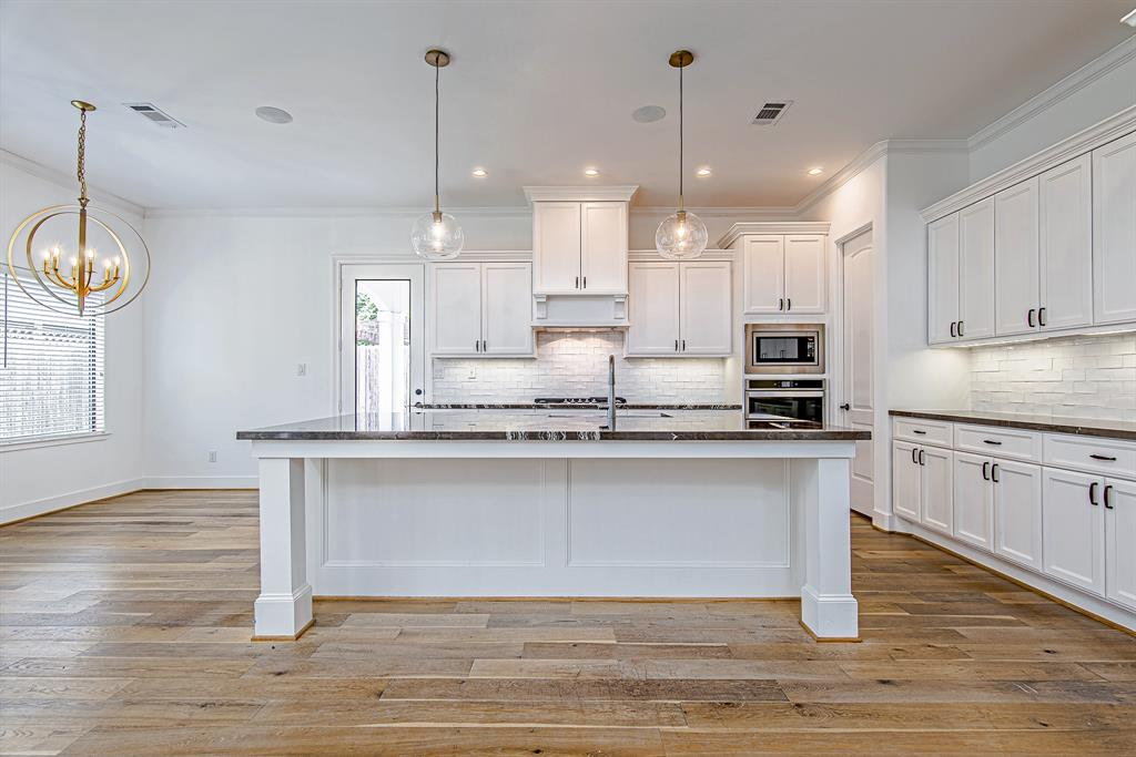 Gorgeous design by Timeline Construction in highly desired Spring Branch. Spacious open floorpan with grand staircase and top of the line finishes and appliances. Large kitchen has a huge eat in kitchen island where guests can gather around. Expansive backyard space with outdoor kitchen and pergola patio, perfect for entertaining. Large covered patio extends off of living area for continued outdoor living space. Designers finishes throughout. Custom built-ins surround the stunning fireplace. Huge master suite and bath with spa tub. Custom closets with endless storage. This is the perfect place to call home, a must see!