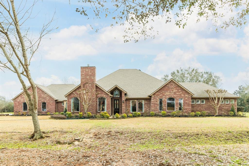 Gorgeous custom 4 bed 4 bath home with pool and 4-car attached garage on 2.57 acres in Sienna Point! Built with accessibility in mind, the high ceilings, wide hallways and ample windows give the home an open feel. Features include formal dining, family room with vaulted ceiling, two studies with built-ins (great for working from home or a school room), kitchen with gas stove, granite counters, butcher block island and breakfast room. Primary and two secondary bedrooms down, fourth bedroom with private bath and kitchenette upstairs. Primary bath has barrier free shower and space for a stationary bike! Huge laundry room with space for fridge or freezer, tons of cabinets and counter space, and a sink. Covered patio out back provides shade between dips in the recently resurfaced pool. Other updates per seller: landscaping with lighting, sprinkler system (rain gauge), A/C units, flooring, epoxy garage floor, interior/exterior paint, invisible dog fence, and roof with solar fans.