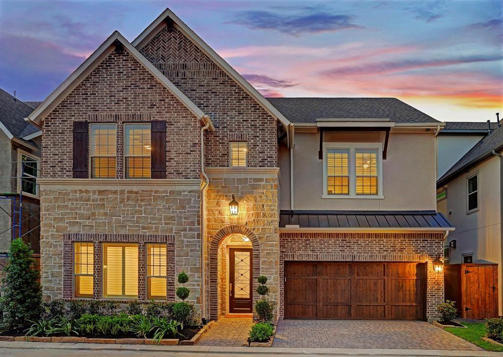 """Gorgeous David Weekley home in gated community zoned to highly-rated SBISD- Memorial HS. 1st floor features 11 ft. ceilings, 8"""" upgraded hardwoods, plantation shutters & crown molding. Open concept living/dining w/floor-ceiling stone fireplace w/custom wood mantel, butler's pantry w/sink, wine fridge & under cabinet lighting. Bright chef's kitchen boasts Granite counters, luxury Monogram appliances, breakfast bar, 6-burner gas cooktop, floor to ceiling cabinets w/interior lighting & walk-in pantry. Formal dining room /first floor office w/oversized storage closet. Primary suite w/sitting area, 8"""" upgraded hardwoods & recessed lighting. Large primary bath w/dual vanities, oversized dual head walk-in shower, soaker tub &2 walk-in closets. 3rd floor living/game room includes wet bar, beverage fridge, 5th bedroom, 4th bath & walk-in storage closet/attic space. Exterior includes covered patio plumbed for outdoor kitchen, zoned sprinkler system & room for pool. Home backup generator ready!"""