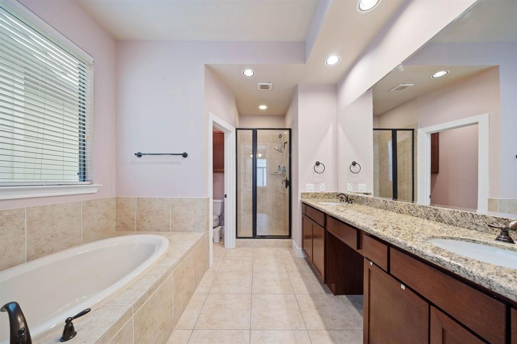 Primary bathroom with separate tub and shower.