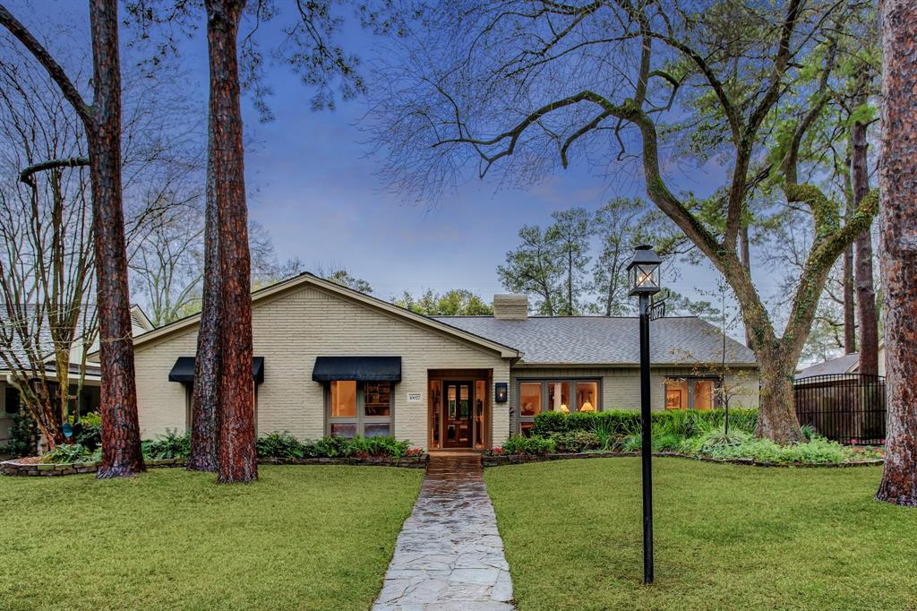 Gorgeous, must-see home on the North side of desirable Briargrove Park. Features include a bright open floor plan, LED recessed lighting, gorgeous hardwood floors, customized closets, camera security system, double pane windows, sprinkler system, double wide driveway, wide and deep carport with 10 foot ceiling and recessed lights, lush landscaping and Aluminum extra wide electric gate. The pool has been refinished with Pebble Tech custom finished. The generous size kitchen features granite counters, stainless steel appliances and recent Kitchen Aide 3 Rack dishwasher. The island provides additional seating and is adjacent to the breakfast room and living room, ideal for entertaining. The living room boasts fireplace and cathedral ceilings with views of the sparkling pool and patio. The primary bedroom features large walk-in closet and updated primary bathroom with double sinks. The garage is extra deep, insulated and ready to be converted into an additional game room. A must see!