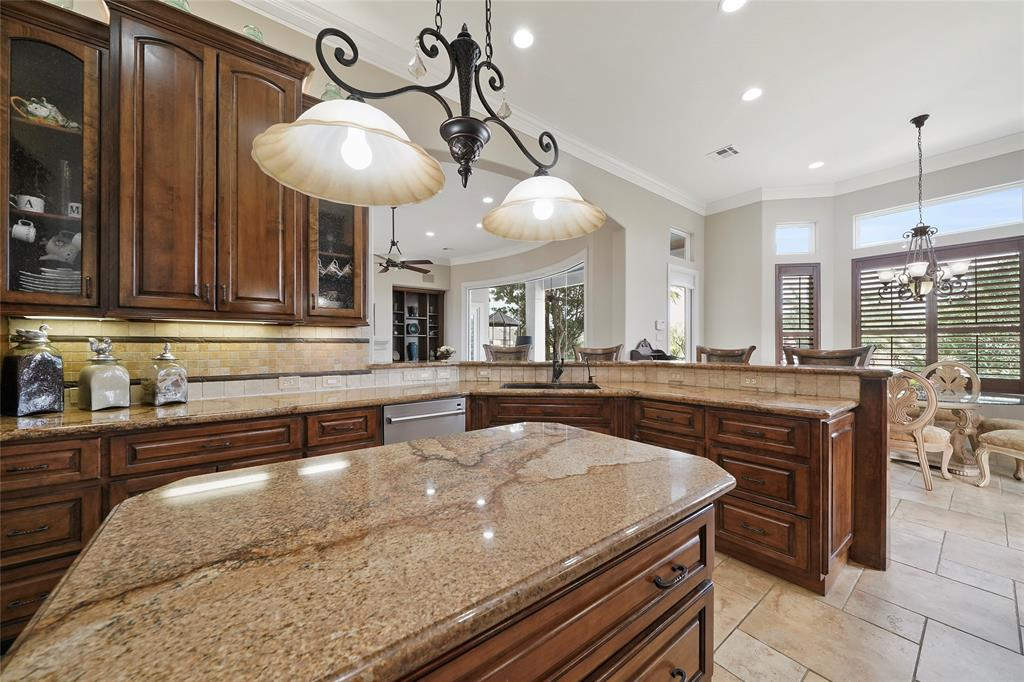 There is ample counter space in this kitchen! The bar provides additional seating for ease of entertaining.
