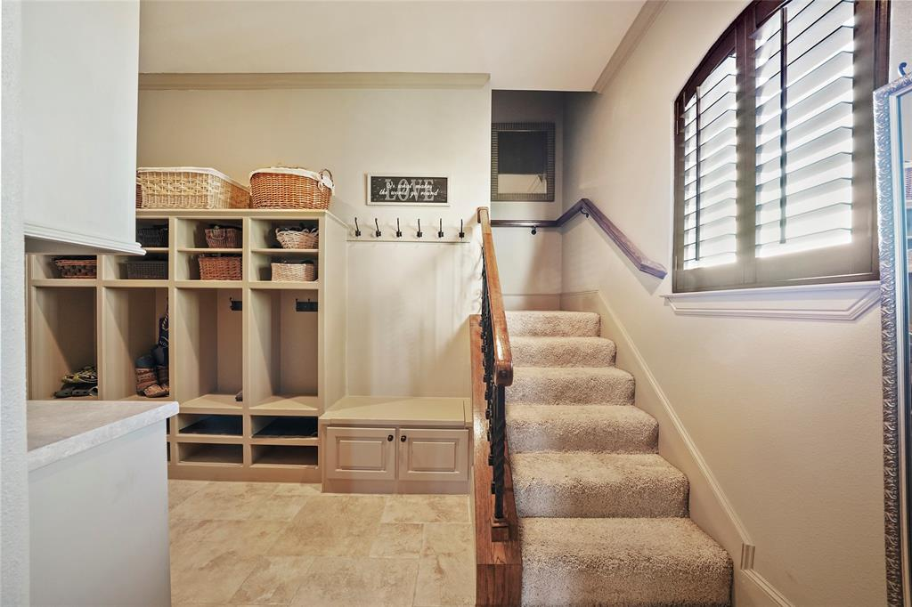 The mud-room off of the garage offers great organization and a bench for putting on shoes. The second staircase is located in this room for convenience.