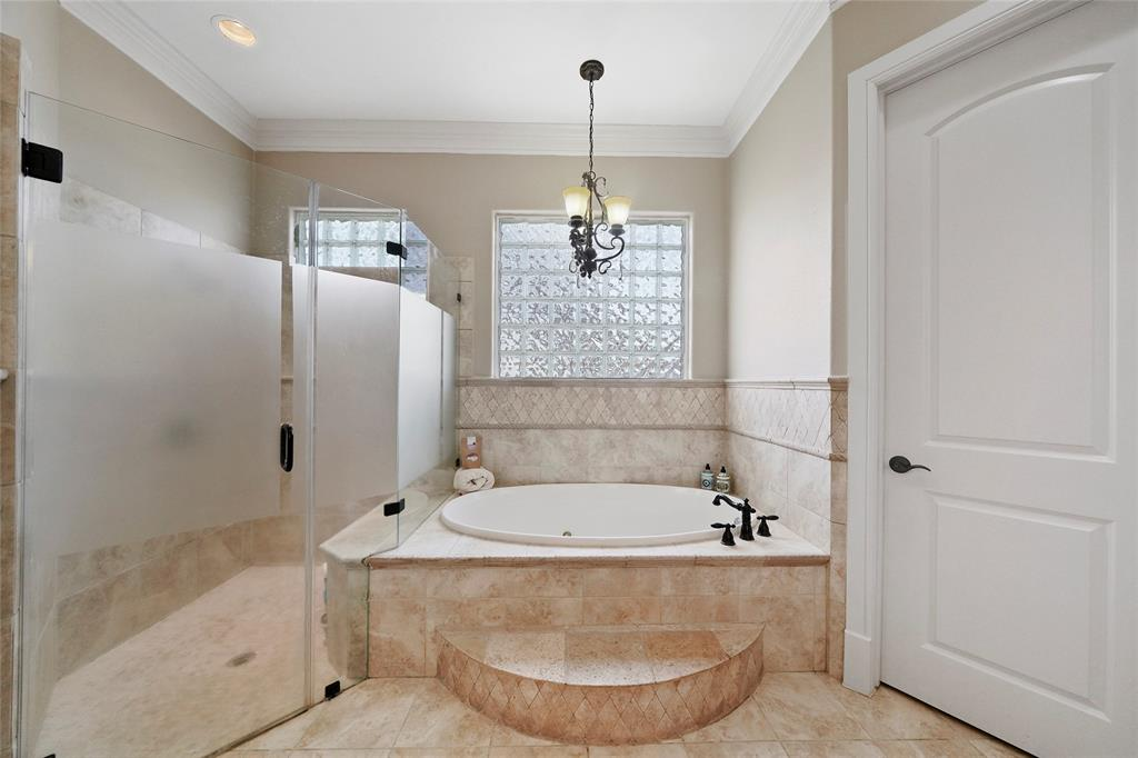 Separate shower, large soaking tub and toilet area. Notice the harlequin wainscoting is continued on this side of the bath for a unified look.