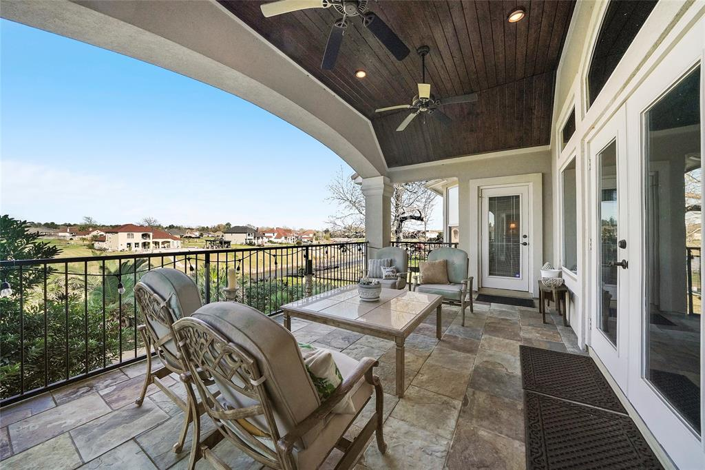 Second floor balcony has a stained wood ceiling, like the first floor, and gorgeous views! Two of the second floor bedrooms also have access to this balcony through a single glass door.