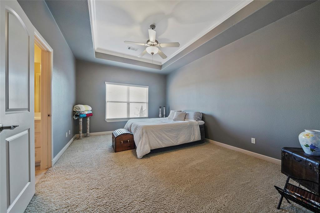 One of the second floor bedrooms with high ceilings, tray ceiling and plenty of space!