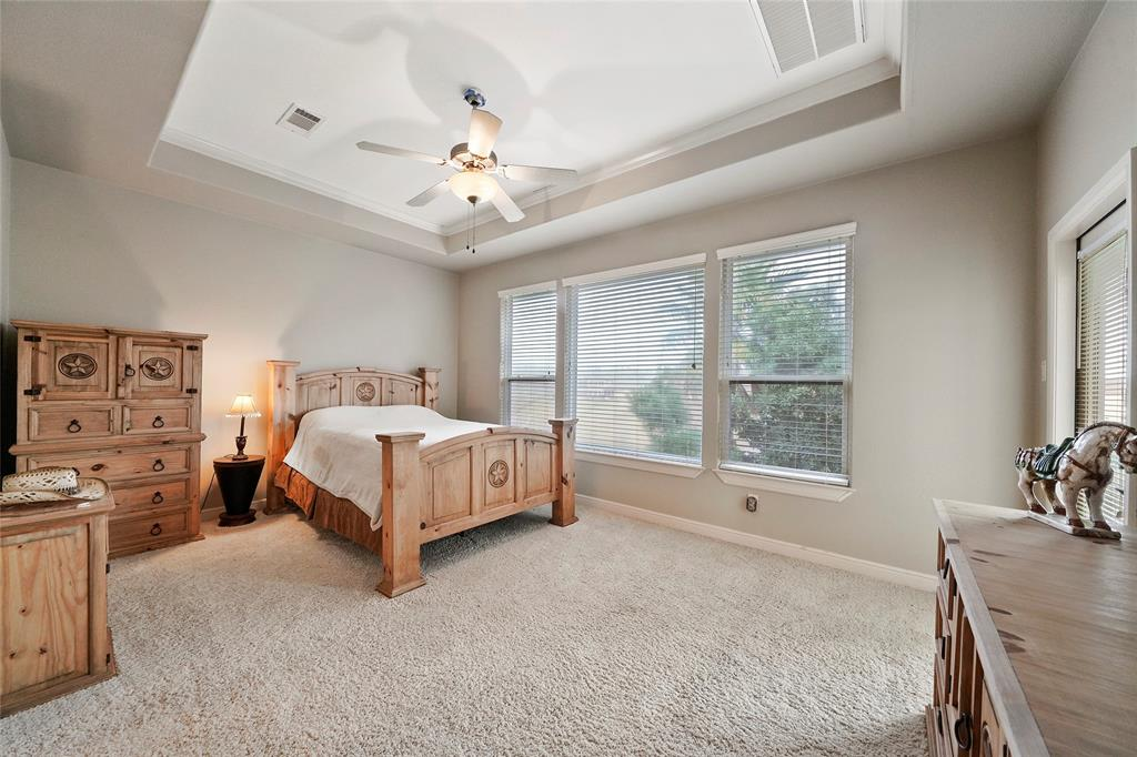 Another large second floor bedroom with access to the balcony. The large window overlooks the backyard.