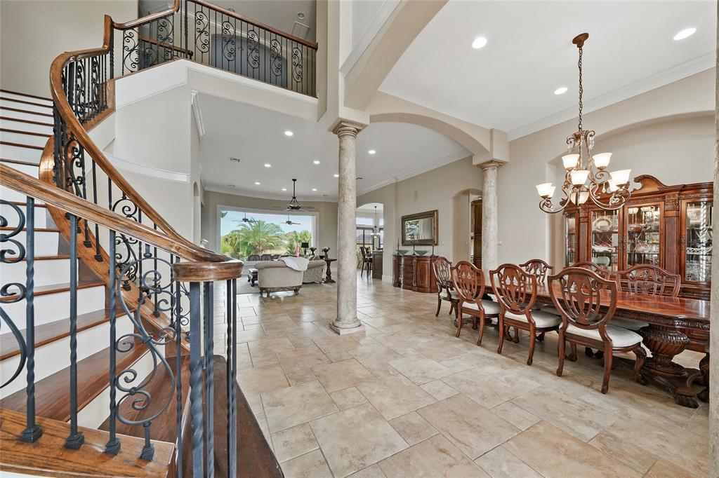 The foyer opens into the formal dining room and living room beyond. An office is just behind in this photo.