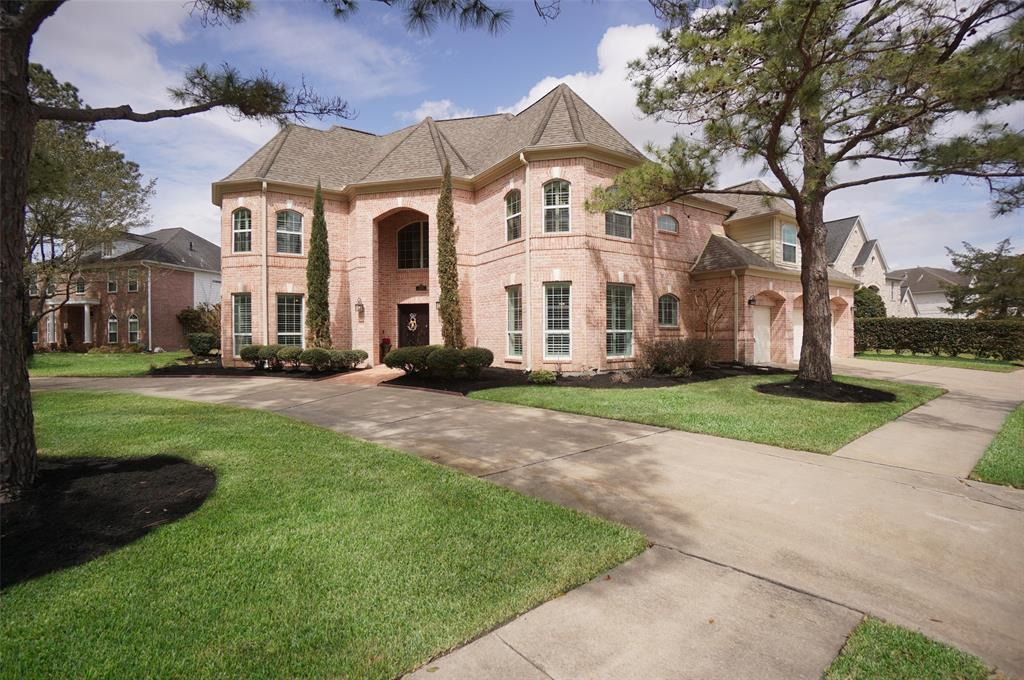 SPECTACULAR HOME! Look no further! Located towards the end of the street & across from a neighborhood park, this updated home is located in a golf course community. HUGE bedrooms & tremendous storage throughout. CHEF'S KITCHEN with gas cooktop & updated white cabinets, granite countertops & stainless steel appliances along with built-in desk. There is a sunny & bright study with doors for privacy off the entry. Custom cabinetry in dining room includes a wine refrigerator which is perfect for entertaining. LUXURIOUS primary bath with freestanding tub & walk-in shower. WIDE PLANK TILE throughout downstairs. Lots of PLANTATION SHUTTERS & UPDATED WINDOWS. Extra room off gameroom is ideal for kid's play area or media room. TROPICAL PARADISE BACKYARD with pool & spa. COVERED PATIO & Palapa are perfect for outdoor dining. Plenty of grassy space for the kids to play or the dog to roam. Excellent Katy Schools! Close to LaCenterra, Whole Foods, many restaurants & shops. Better hurry!