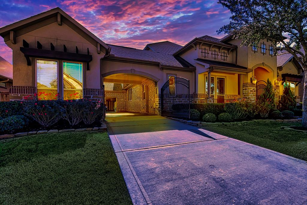 Captivating beauty envelopes this traditional home on a gorgeous lot graced by mature trees and professional landscaping. This stunning residence boasts extraordinary millwork throughout reflecting a blend of inspiration and beautiful architecture. This one and a half story home has a dynamic entry, gracious floor plan with family room opening to gourmet kitchen with granite counters, travertine backsplash, stainless steel appliances, double ovens, five burner gas cooktop and oversized breakfast bar. Home office, private master suite plus two guest suite downstairs, elegant formal dining room, sweeping staircase with wrought iron balusters Wood hand railing, game room, media room, backyard has covered patio and outside grill station, plus 3-car Court garage. interior courtyard and wrought iron privacy gate. This residence is a real Diamond! Bring your buyers!!! Thank you for showing!!