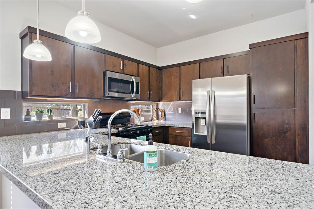Abundant counter top space in the kitchen. Modern appliances and cabinetry.