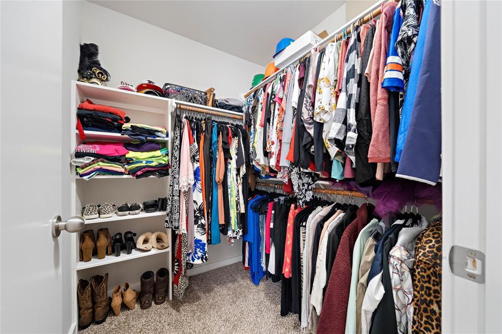 Primary bedroom walk-in closet.