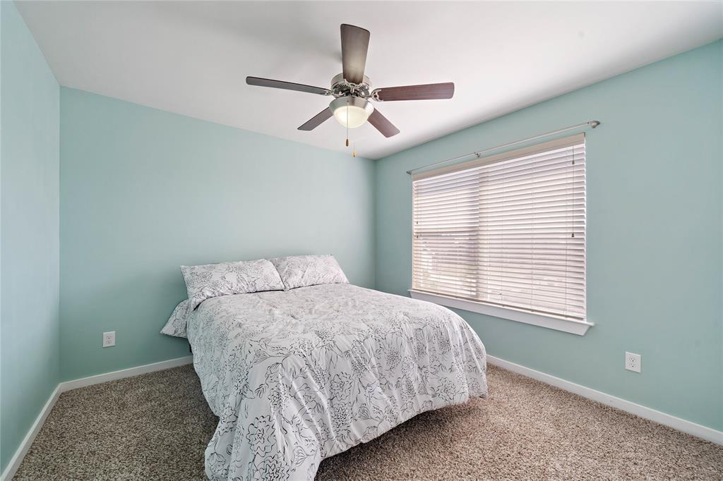 Secondary bedroom used as guest bedroom.
