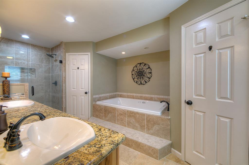 Master bath, double sinks, Shower and separate tub, his and hers closets.