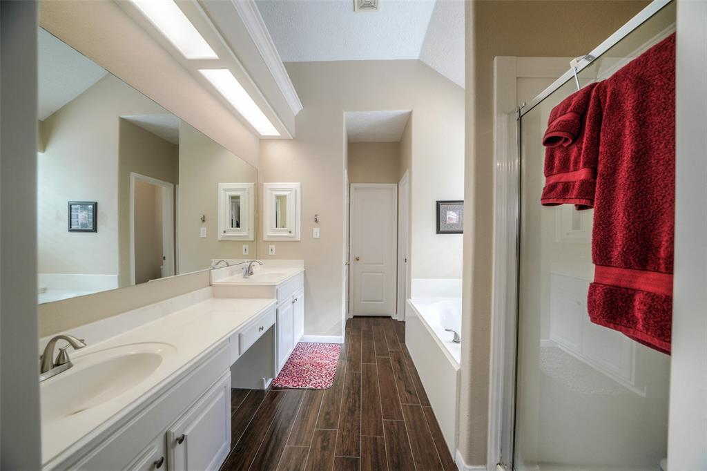 The primary bathroom has double sinks, a separate shower and bath tub. Past the bath tub is a massive closet, where you'll have room to spare.