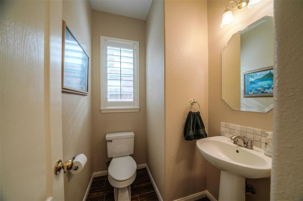 This half bathroom is located on the first floor past the family room.