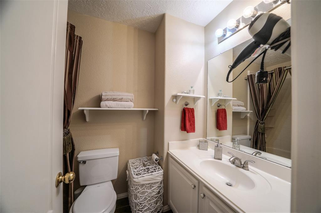 This full bathroom is located between two of the secondary bedrooms. The bathtub/shower were replaced in 2018.