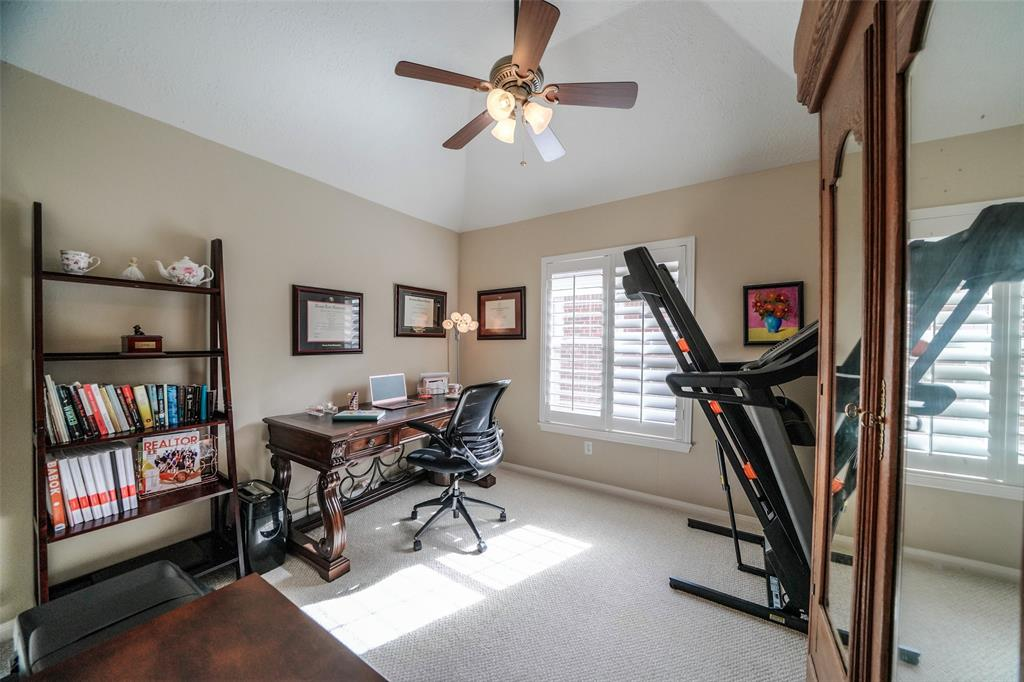 This secondary bedroom is currently used as an office/gym, which comfortably fits large furniture.