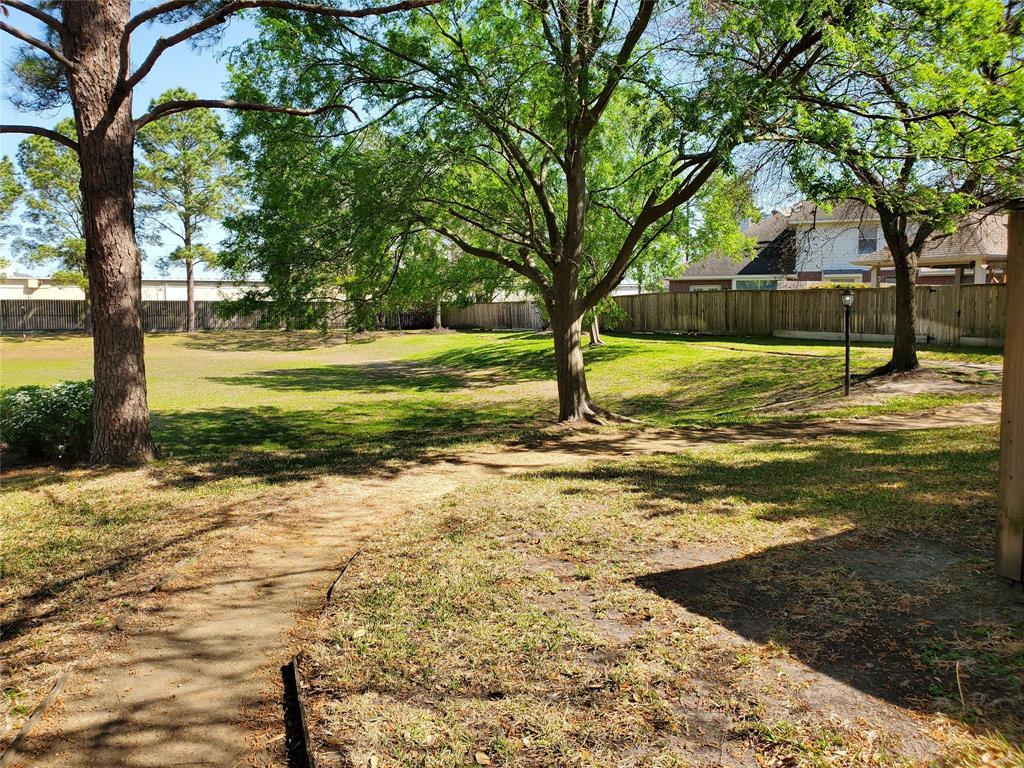 Just a few houses down, there is a private park within this gated community with mature trees and a walking/running trail for residents to enjoy.