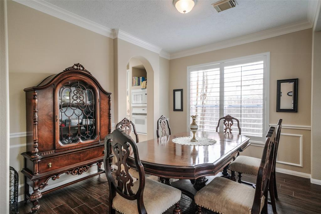 This formal dining room can easily accommodate an eight-person table. Again, light floods the room through the plantation shutters.