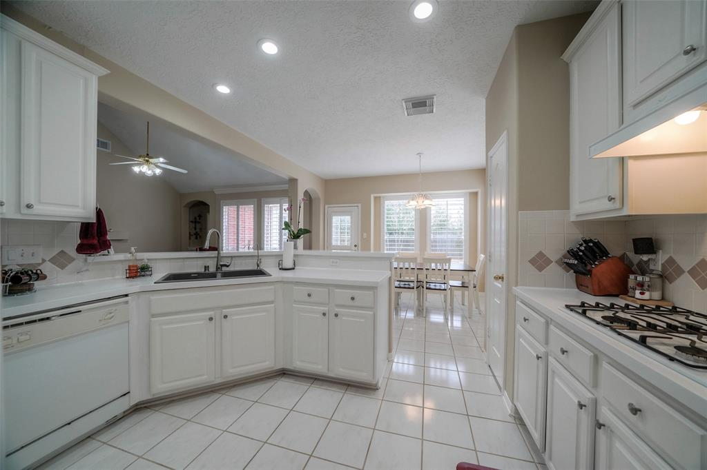 This spacious kitchen has plenty of cabinet space, a gas cook top, and a motion sensor faucet. Microwave and stove (not pictured) are directly to the right if entering from the formal dining room.