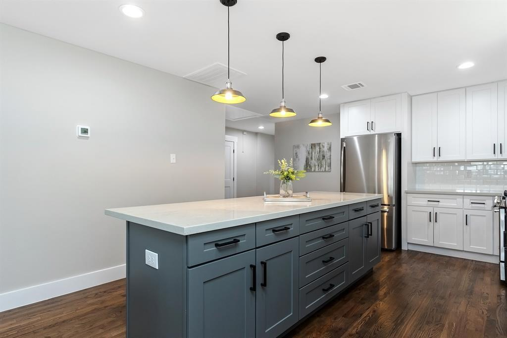 The palette in this property is clean and fresh, with classic finishes throughout including white subway tile backsplash.