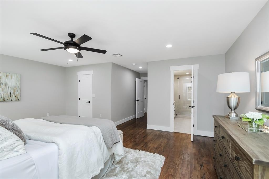 The door to the left is to a big walk-in closet, and the generous primary bath is through the door to the right.