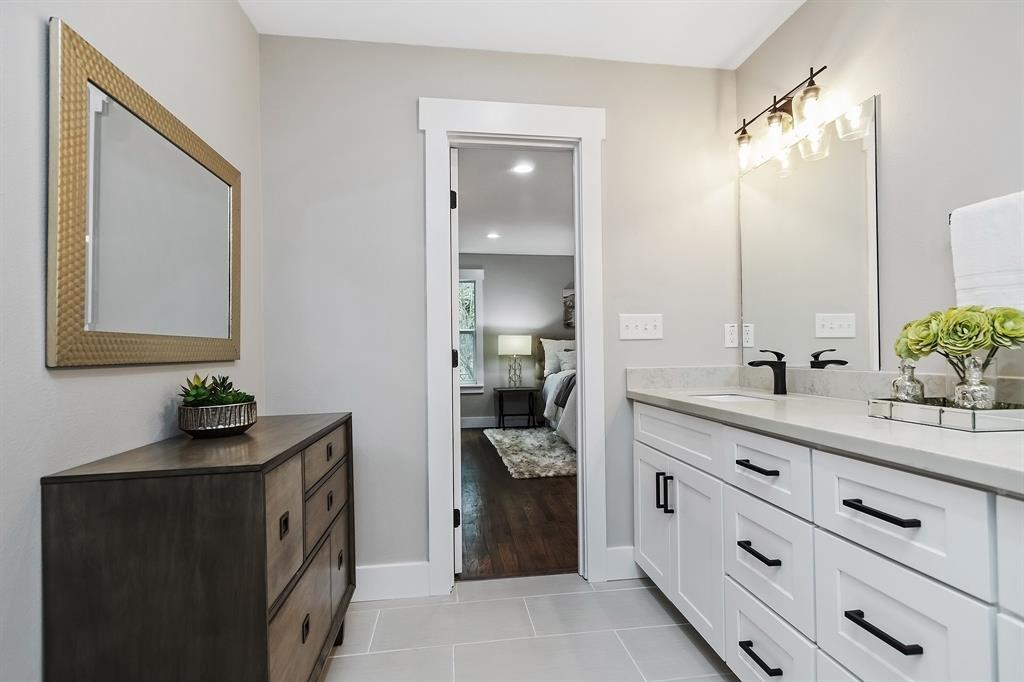In addition to the double bowl vanity with tremendous cabinet and drawer space, there is room for another furniture piece if desired.