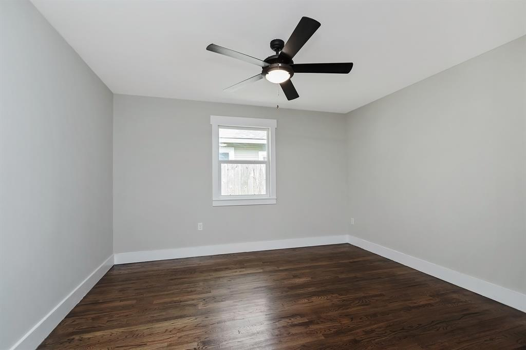 The third bedroom, also located off the living area and shared hall with the second bedroom and full bath.
