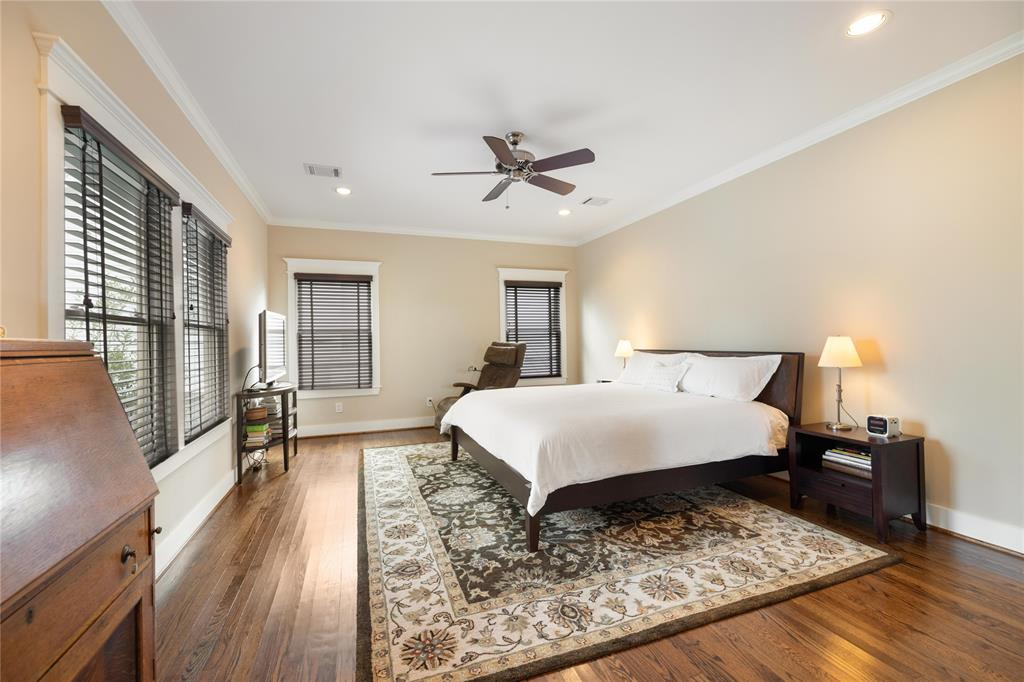 The master suite is absolutely huge. Plenty of room in this master bedroom for a king sized bed and separate seating. It also includes hardwood floors and recessed lighting.