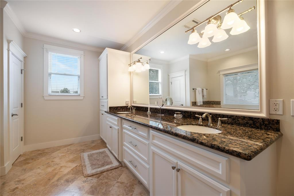 The master bath offers a lot of space for storage and to move around. The vanity includes a two sinks and a giant vanity mirror. Master bathroom also includes a water closet.