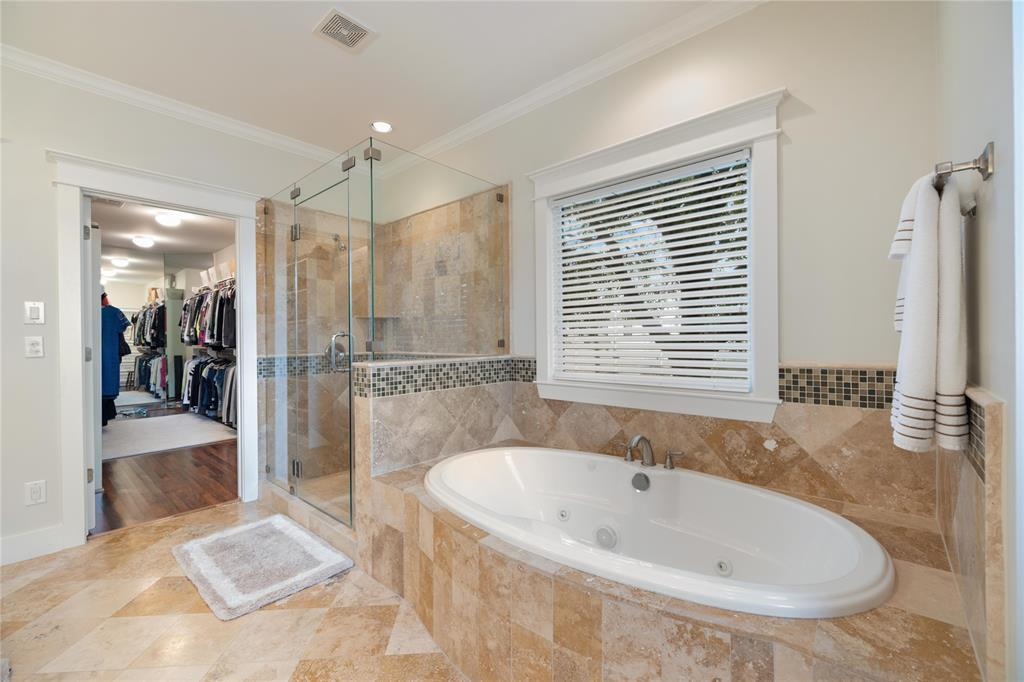 After a long hard day at the office, enjoy a relaxing afternoon in this huge jetted tub. You'll also find a separate shower and a really, really big master closet.