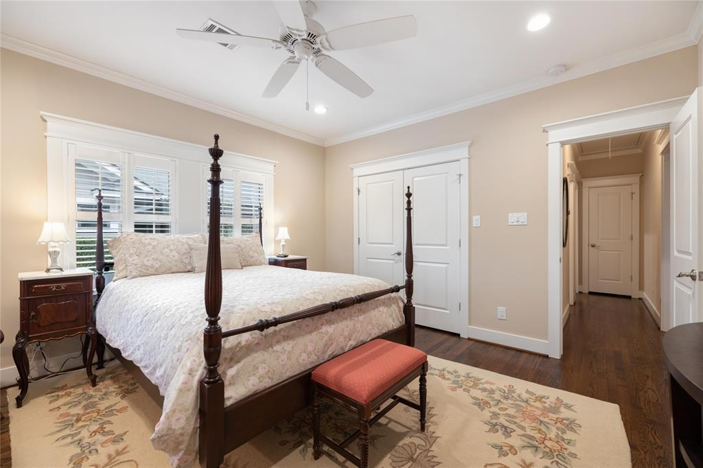 Both of the secondary bedrooms include recessed lighting, hardwood floors, and generous closet space.