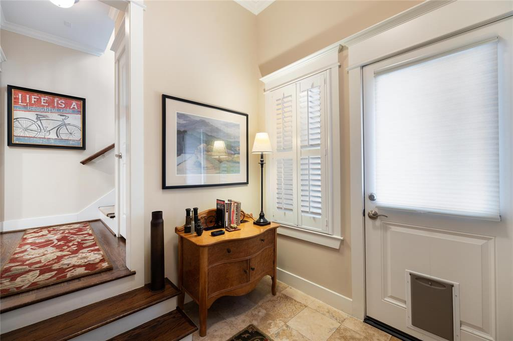 The over-sized garage is attached and located off this large mud room entryway.