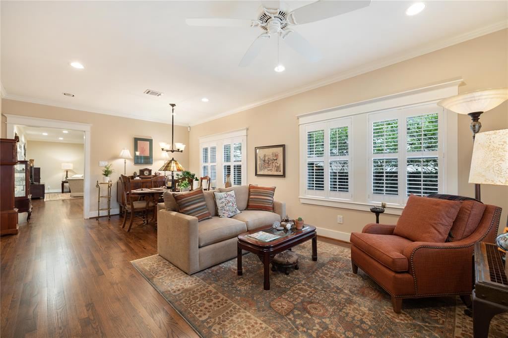 The large open den area is open to the dining space. This space is great for entertaining or relaxing in the afternoon.