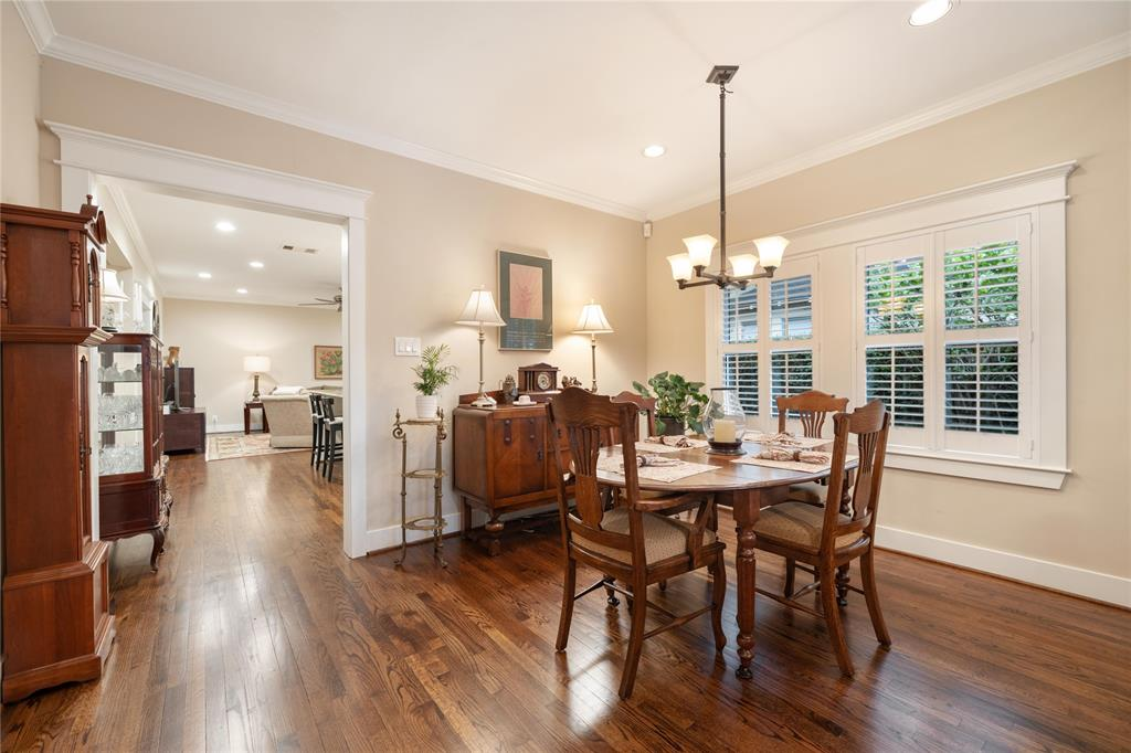 This space also includes beautifully finished hardwood floors, crown molding, and recessed lighting. You're also going to love the classic trim work throughout this Heights home.