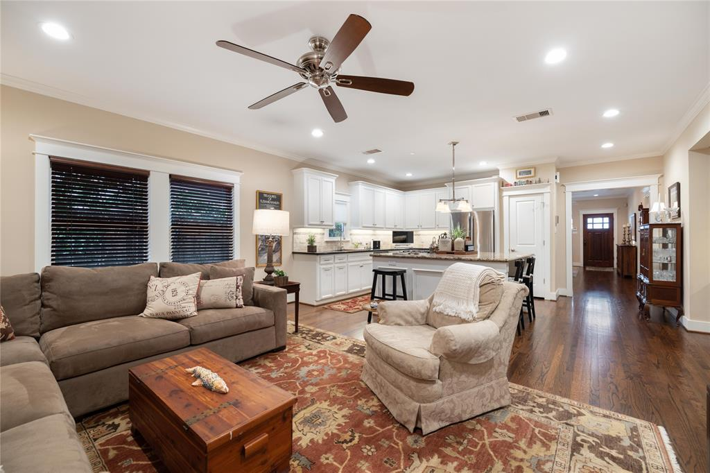 In the main living space, the center island kitchen is open to the family room. This floor plan provides a wonderful area to congregate and relax. These rooms also include solid hardwood floors, recessed lighting, and crown molding.