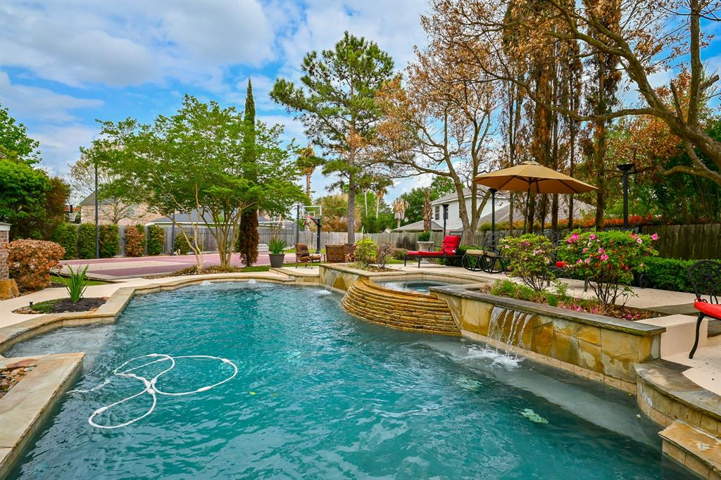 GATE CODE 1211. Fabulous Partners in Building custom 5/4.5/4 on a true culdesac lot in a gated community-with a enormous back yard!! Large custom heated POOL and SPA,outdoor kitchen,lots of decking,lawn turf,and a PROFESSIONAL 33x55' SPORT COURT with 2 regulation BASKETBALL GOALS,VOLLEYBALL NETS and professional LIGHTING. You must see this incredible back yard!! Impressive 2 story foyer,beautiful study,incredible gourmet island kitchen with granite countertops,stainless appliances and oversized pantry. 2 dining areas,3 living areas (including a very large game room),lavish master suite down with spacious sitting room and big executive bathroom. There is also an added 6th bedroom or second study/hobby room.  2 staircases,2 fireplaces ,heavy crown molding,beautiful wood trim,upgrade hardwood floors,recessed ceilings,custom plantation shutters,3 secret closets,walk in wet bar,Juliet balcony and much,much more. New roof 2020, full interior and exterior paint in 2021. FOUR CAR GARAGE,