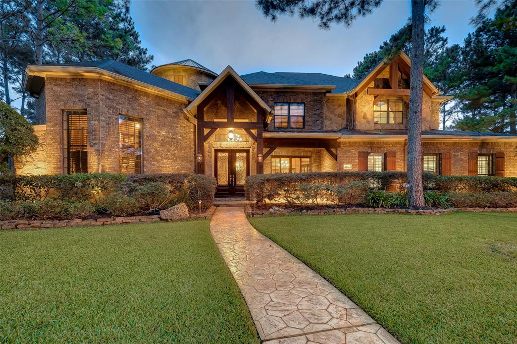 Absolutely stunning 1 of a kind Hill Country style residence on an over-sized secluded culdesac lot in the highly desired, gated Bayou Pines Cinco Ranch. Forest setting almost .5 acres. NEW ROOF 12/19! Covered front porch, 2nd floor covered balcony & back patio which is ready for outdoor kit. Hand scraped hardwoods, chiseled tile, stamped concrete, cedar beams, brick arches, stacked fieldstone, stain grade Alder wood doors/moldings/finishes & custom built-ins, Benedettini cabinets, Granite countertops, stainless appliances, gas available for cooktop change, front paneled refrigerator, HAI Smart Home System/NUVO sound. 2nd Bedroom downstairs w/ full bath & access from pool. Amazing resort style backyard with gorgeous pool/spa/grotto/ beach entry and tree-lined backdrop w/walking path access.  8' doors and 10' ceilings 1st floor. 3 car garage with extra climate controlled storage room/workshop. All Cinco amenities! Seven Lakes HS & Beckendorff JH! Pics contain more details. NO FLOODING!