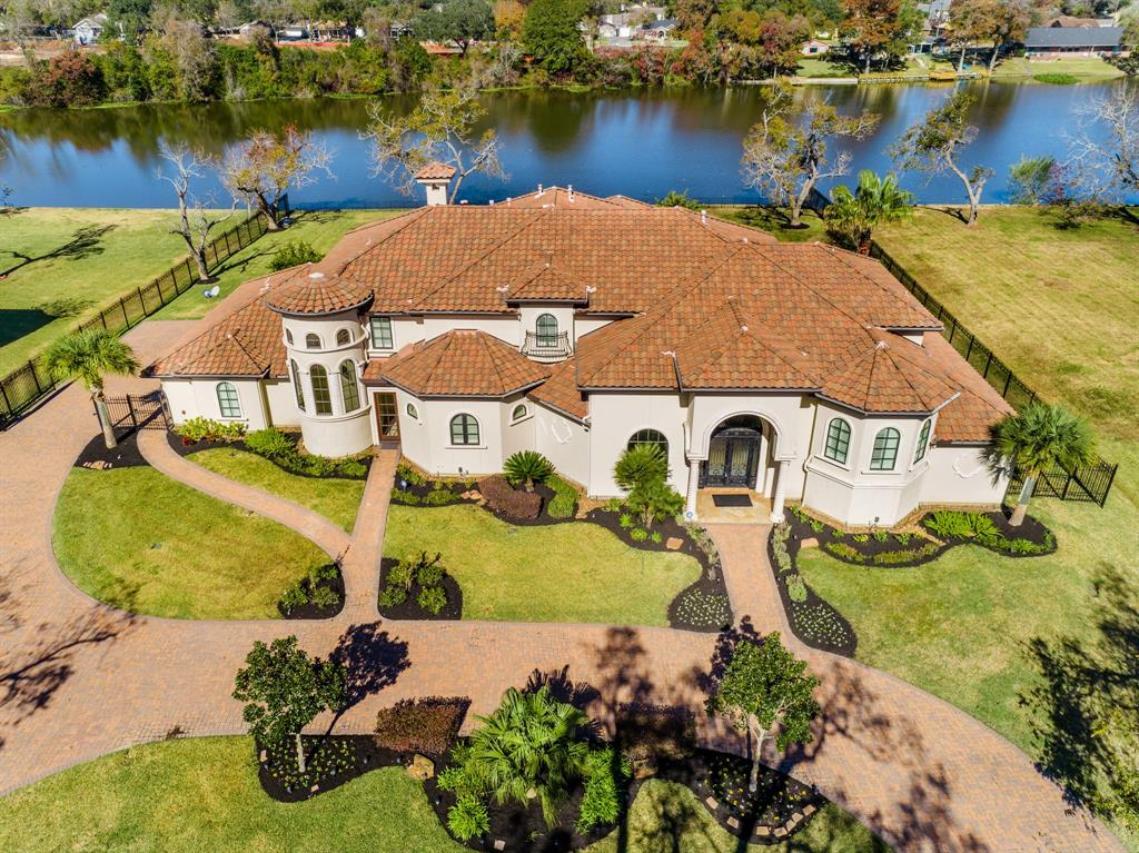 LUXURIOUS CUSTOM WATERFRONT HOME SITUATED ON A 1 ACRE LOT IN THE PRESTIGIOUS GATED COMMUNITY OF THE ORCHARD! GORGEOUS FRONT ELEVATION W/STUCCO & TILE ROOF. DOUBLE IRON DOORS LEAD TO A DRAMATIC ENTRY W/SOARING CEILINGS, CUSTOM RAILING & DOUBLE CHANDELIERS. ELEGANT FORMAL LIVING & DINING ARE PERFECT FOR ENTERTAINING. LUXURIOUS MASTER SUITE W/SPA-LIKE MASTER BATH AND ENORMOUS CLOSETS!  EXTRA LARGE FAMILY ROOM IS PERFECT FOR LARGE GATHERINGS & FLOWS INTO A STUNNING KITCHEN W/OVERSIZED ISLAND, CUSTOM CABINETRY, HIGH-END WOLF APPLIANCES, 2 DISHWASHERS, 2 OVENS, 2 MICROWAVES, SUB-ZERO FRIDGE, VEGGIE SINK & BUILT IN STEAMER. TERRIFIC FLOOR PLAN W/2 MASTER BEDROOMS, 2 BEDROOMS DOWN, HANDSOME STUDY, GAME ROOM, MEDIA ROOM, & BONUS ROOM/GYM. PANORAMIC WATER VIEWS! GORGEOUS POOL WAS ADDED IN 2017. MULTIPLE OUTDOOR SEATING AREAS, BALCONIES & OUTDOOR KITCHEN! CONVENIENTLY LOCATED IN THE HEART OF SUGAR LAND W/EASY ACCESS TO MAJOR FREEWAYS, SHOPPING AND FINE DINING! LOW TAX RATE! FORT BEND SCHOOLS!