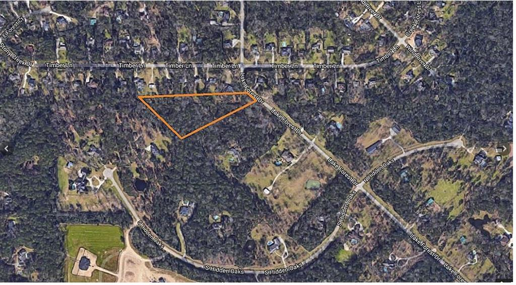 We have teamed up with Termeer Custom Builders to build on this land. I have included pictures of the houses they already build. Enjoy the peaceful surroundings of this beautiful, wooded, high, and dry 5-acre lot in sought-after Red Oak Ranch. Take a walk on the path as you plan your dream home in a serene setting. An expansive wooded lot close to The Woodlands amenities. Horses are allowed.