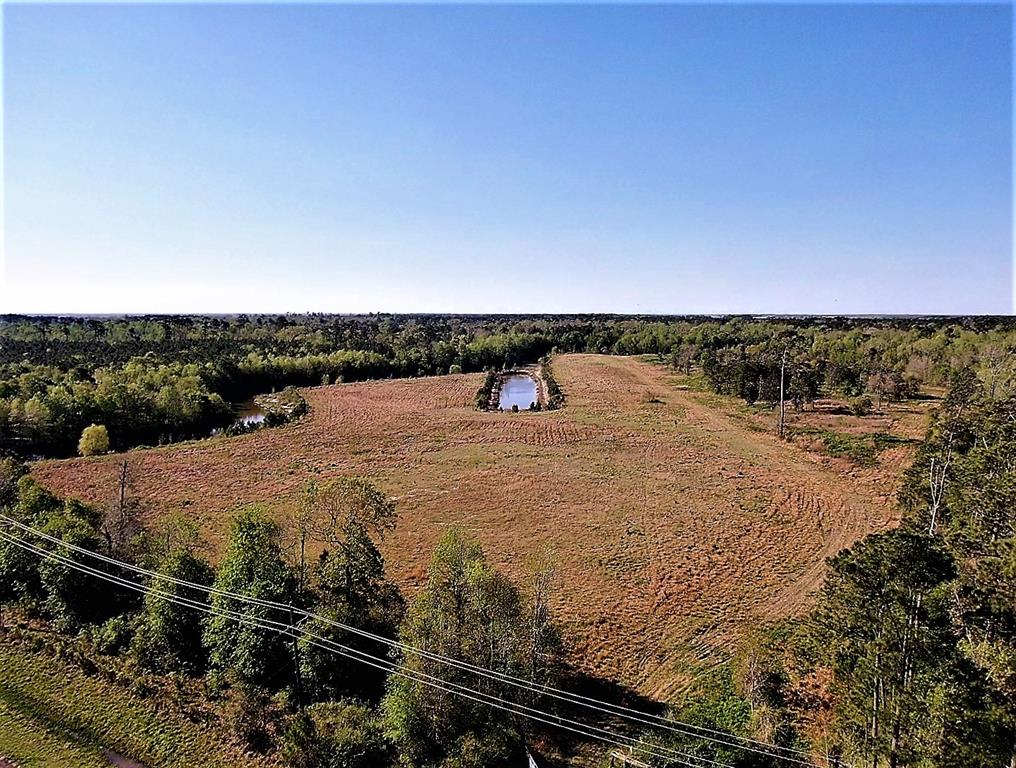 This property has approx. HALF of it's boundaries on Double Bayou. Double Bayou is approx. 7/9 feet deep (per seller) and runs all the way to Trinity Bay and local restaurants in Oak Island. Water and Electric are available at the street. Unsure of septic type allowed (Contact Chambers County). This property also has a man-made gully that was built to bring oyster boats into, has naturally attached to Double Bayou. Beautiful piece of land for your home, ranch, RV Park or boat storage.
