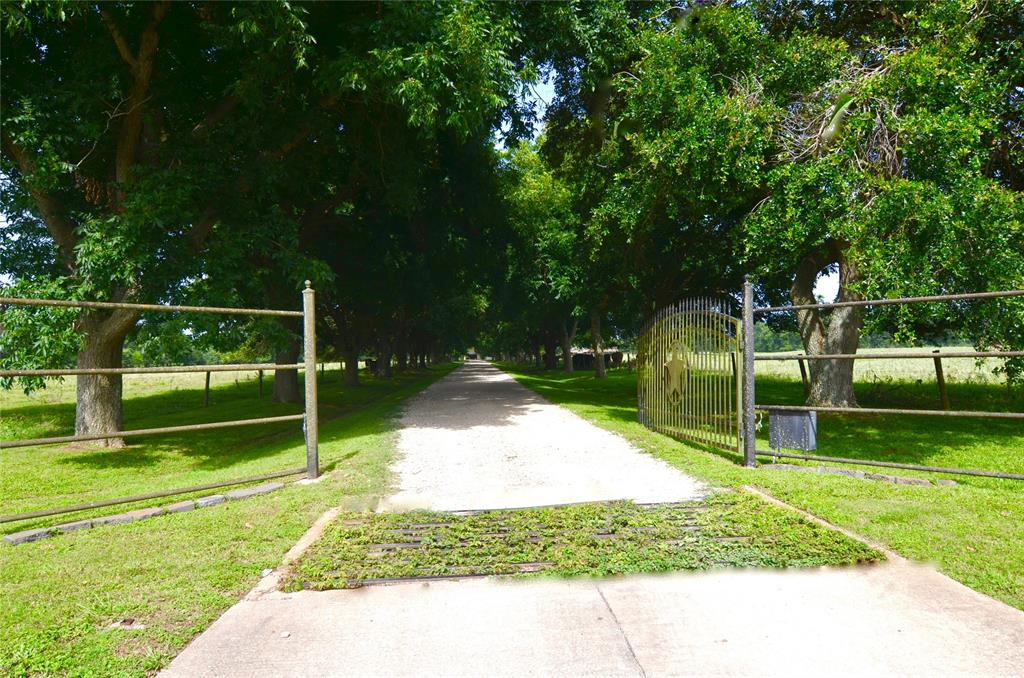 """FOR NEW DEVELOPMENT or YOUR PRIVATE ESTATE & DEVELOP LATER!!!!  FM 359 CATTLE RANCH W/ HISTORY!!  FIRST TIME ON MARKET IN 80+ YEARS.  ADJOINS PLANTATION PLACE & CLOSE TO PECAN GROVE PLANTATION & OTHER COMMUNITIES. THIS LISTING IS FOR 17 ACRES OUT OF 56 ACRES & INCLUDES A BEAUTIFUL MODERN RANCH HOME (APPROX 50 YRS OLD) W/ APPROX 3911 Sq Ft,  4/3/1/2/5 & A PVT POOL SURROUNDED BY VINTAGE TREES.  ALSO SEE NEW LISTING FOR ADJOINING  10 ACRES W OPTION TO PURCHASE ALL OR PART OF THE 56 ACRE RANCH.  PLS SEE (MLS 75103621) LISTED UNDER COUNTRY PROP/ ACREAGE FOR 10 ACRES.  RANCH IS UNRESTRICTED W/ AN AG EXEMPTION.  IN  HIGH-DEMAND"""" LOCATION  FOR SMALL OR LARGE COMMERCIAL, MULTI-USE OR RESIDENTIAL DEVELOPMENT.  CLOSE TO HWY 90 & HWY 99  (THE GRAND PKWY) &  HWY 59. PLS SEE PRELIMINARY SURVEY UNDER """"ATTACHMENTS.""""  HOME CURRENTLY OCCUPIED BY TENANTS.  UNIQUE OPTION TO PURCHASE ALL OR PART AT A GREAT PRICE!!!"""