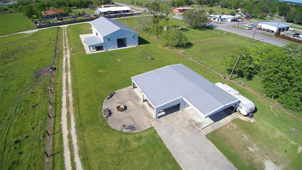 Incredible opportunity to own a uniquely Texas property in Matagorda county, 80 miles from Houston. 2 barndominiums await with 18' barn doors and 22' ceilings. 9000 covered sf combined, with 5000 additional sf of patio. 8+ TVs with cable & Direct, surround sound, internet jukebox, movie screen and projector. Firepit, iceboxes, fully equipped kitchen w/granite counters, ss appliances, wine cooler. 2 apartments w/ add'l sleeping quarters. This place was designed with an overdose of fun in mind! Acreage is ag exempted with cows and a pond on the back acreage! 1250 ft of Hwy 60 road frontage, and CITY UTILITIES. RV hookup & pad. Parcel is adjacent to an additional 118+ ag exempt acres with 70' of Hwy 60 frontage, a clay shooting operation with Mattarelli machines and an FAA approved helicopter pad. See drone video, web link and attachments for additional details. Fly into Hobby and hop a heli at Million Air and let us show you around this unique property.