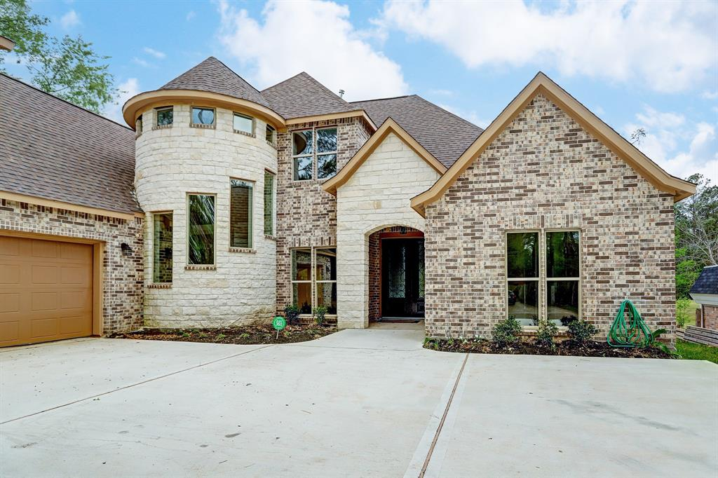 There is someone looking for a brand new home, built near a golf course, with so many rooms and amenities that the home can accommodate a large number of individuals. This New construction house located in  River Plantation, is that home. This beautiful home is backing to the River Plantation golf course. It   features: custom trim, luxury flooring, quartz throughout, long driveway, brick/stone exterior and oversized garage. Three bedrooms  and 2.5 bathrooms downstairs; two rooms and full bath upstairs. Primary bedroom is downstairs with an elegant coffin ceiling, back patio access and golf course views.  Primary bathroom has jetted tub and glass ceiling with beautiful waterfall tile. Upstairs there is an open area with built-in desk. Living area has 24ft ceilings and floating fireplace! Kitchen features custom cabinetry with soft closing drawers and cabinets, two tone quartz with luxury leather texture!