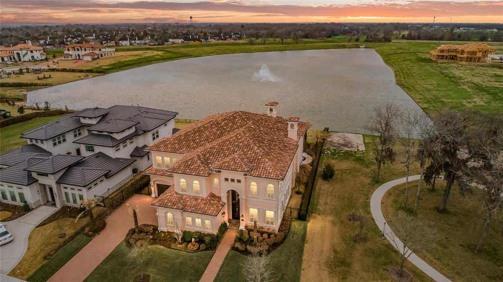EXQUISITE WATERFRONT MEDITERRANEAN HOME, LOCATED IN LAKES OF WILLIAMS RANCH, A PRIVATE, GUARDED/GATED ESTATE COMMUNITY. THIS FUQUA ROTH CUSTOM HOME OFFERS A GRAND FOYER, SOARING CEILINGS, WINE CELLAR, GOURMET KITCHEN, MEDIA ROOM LOCATED ON THE 1ST FLOOR, WET BAR, COFFEE BAR, EXPANSIVE MASTER WITH BEAUTIFUL VIEWS OF THE POOL AND WATERFRONT, 2 STORY GLAM CLOSET, 3 FIREPLACES, OUTDOOR KITCHEN, INFINITY POOL W/SPA, WATER FILTRATION SYSTEM, MOSQUITO MISTING SYSTEM, SPRINKLER SYSTEM, AND HIGH-PERFORMANCE SOLAR CONTROL FILM ON ALL WINDOWS FOR PRIVACY.