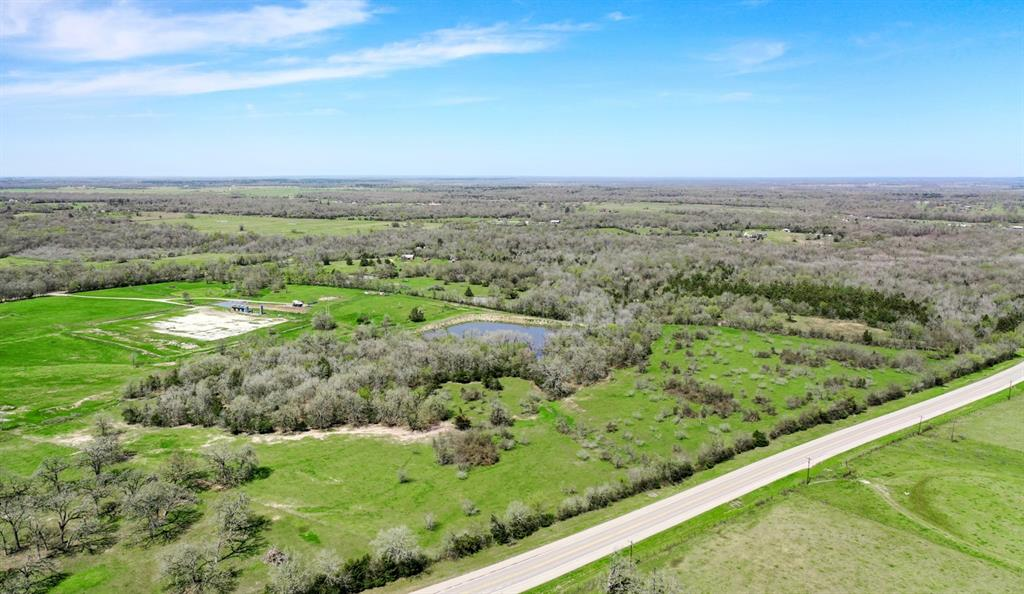 Are you looking for the perfect spot to build? Look no further! This beautiful 28+/- acre tract is ready for you!! Small farm, country estate or weekend cabin, you decide! Have you always wanted a pond? No problem! Bring your gear and enjoy fishing in your stocked 2-acre pond. Partially wooded with a water well and electric access nearby, the options are many!  Call Today!