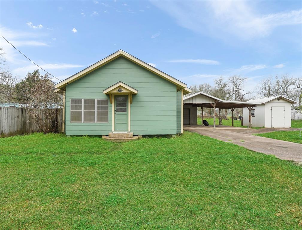 Welcome home to 3414 Commerce Street! This home offers 1,038 sq/ft of living space on a huge 13,499 sq/ft lot with 2 bedrooms, 2 full bathrooms, sits on a quiet street, and all zoned to Damon ISD! You'll love all the features this home has to offer, including a large primary suite, spacious living room, mud room, wood cabinets, covered back patio, detached garage with carport, storage shed, and so much more! This home is minutes from Highway 36 - in an excellent location! Schedule your private showing today!